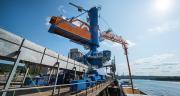 Le plan d'investissement 2012-2018 de 50 millions d'euros a notamment permis, en 2015, le remplacement et l'installation de nouveaux portiques de déchargement. La capacité totale d'exécution est portée à 10000 tonnes par jour. Photo : Sénalia